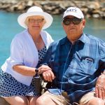 Senior couple by water